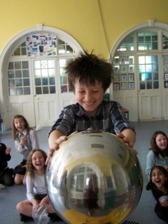 Hair raising fun with the van de graaff generator at a boys science birthday party in Somerset