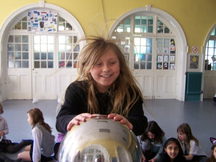 Enjoying learning about science and electricity at a girls 9th birthday party