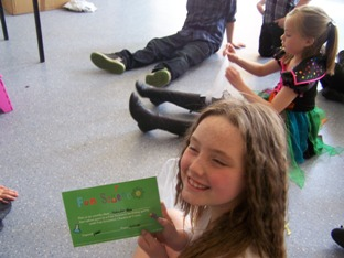The birthday girl with her certificate given to her at her kids science birthday party!